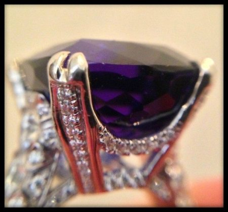 Detail: tanzanite and diamond ring by Omi Privé.