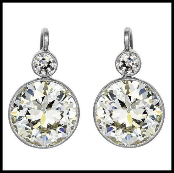 6.87 carat old European cut diamond earrings.