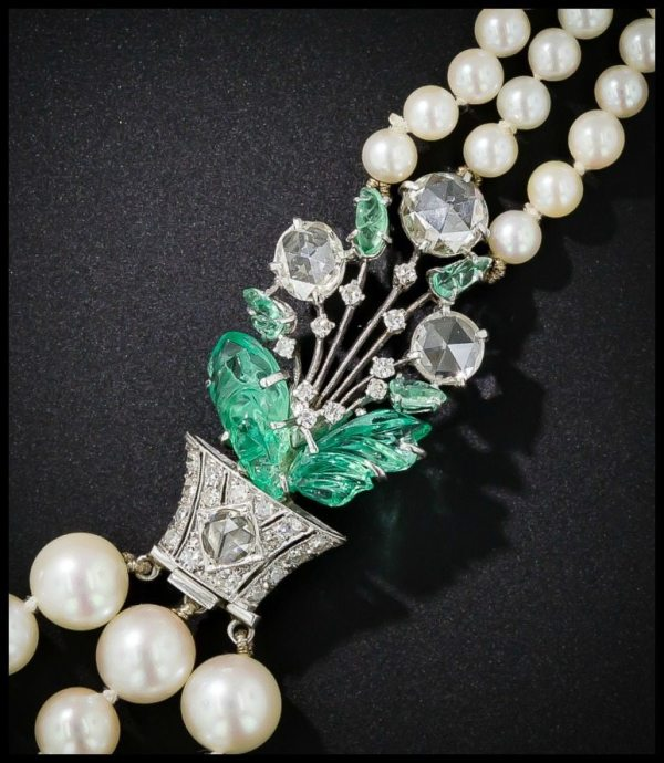 Clasp detail floral motif in carved emeralds and rose-cut diamonds on an Art Deco pearl necklace by Boucheron.