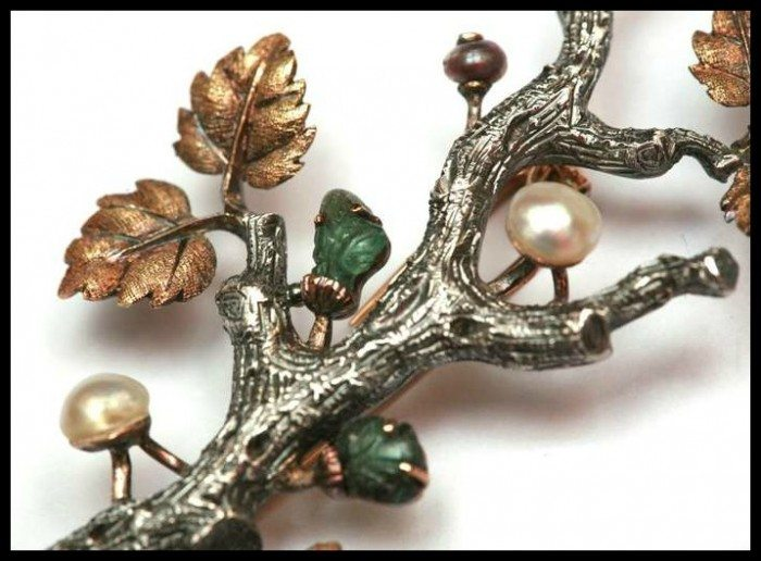 Detail Buccellati white and yellow gold branch brooch with carved emeralds and pearls.