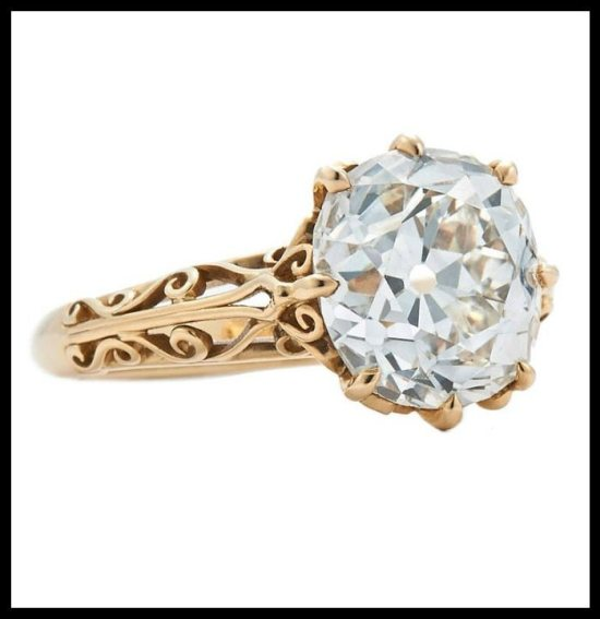 Fred Leighton yellow gold filigree engagement ring with a 4.62 carat JVS1 Old Mine cut diamond center stone.