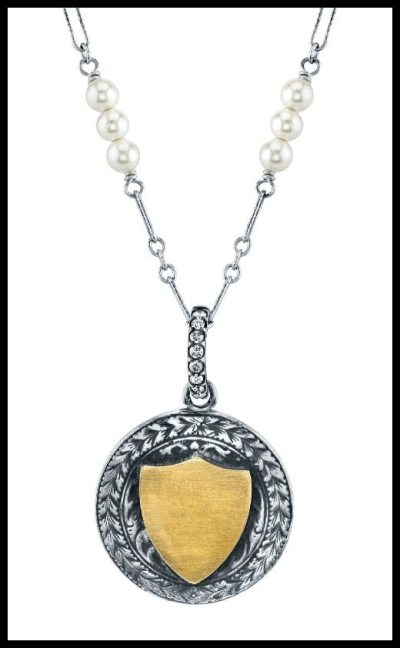 Gold, sterling silver, and diamond pendant by Anabel Higgins.