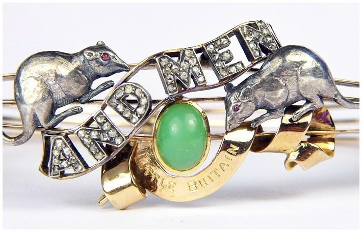 Detail antique Edwardian Of Mice and Men bangle in gold and silver with jade, garnets, and diamonds.