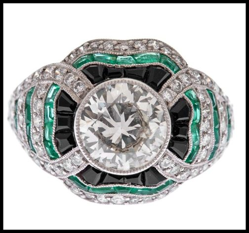 Art Deco-style diamond, emerald, and onyx ring. Via Diamonds in the Library.