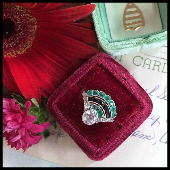 The beautiful Mulholland, an antique Art Deco fan ring with diamonds, emeralds, and onyx.