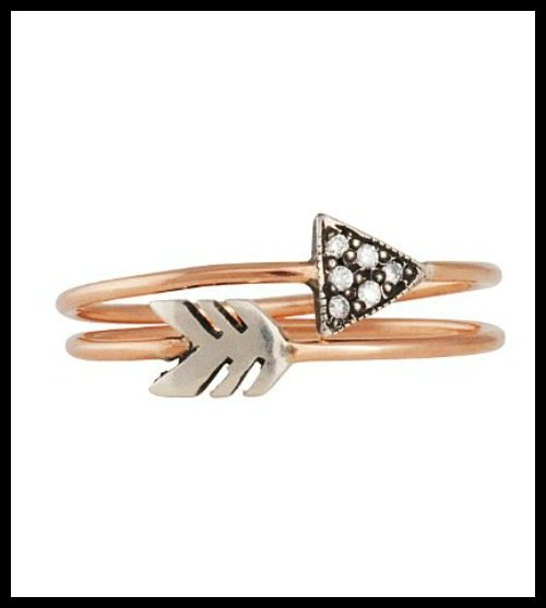 Workhorse yellow gold arrow stacking rings with diamonds.
