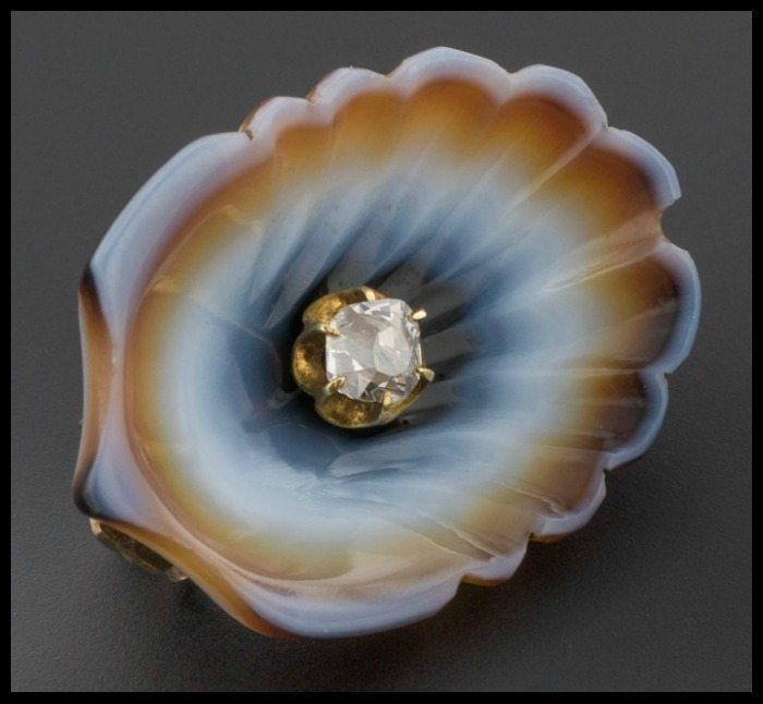 This Victorian brooch looks like a seashell, but it's actually a carefully carved banded agate with a diamond set in gold. Available at Trademark Antiques.