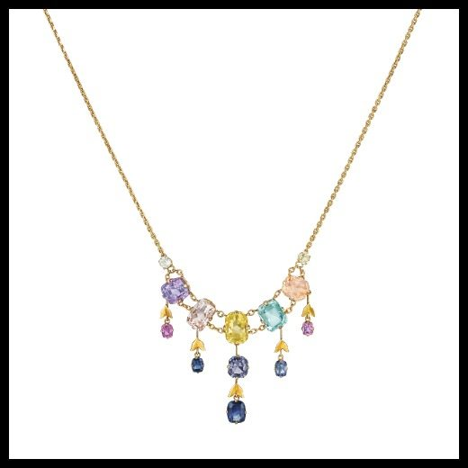 Lovely gold and gemstone necklace with sapphires, aquamarine, and spinel.