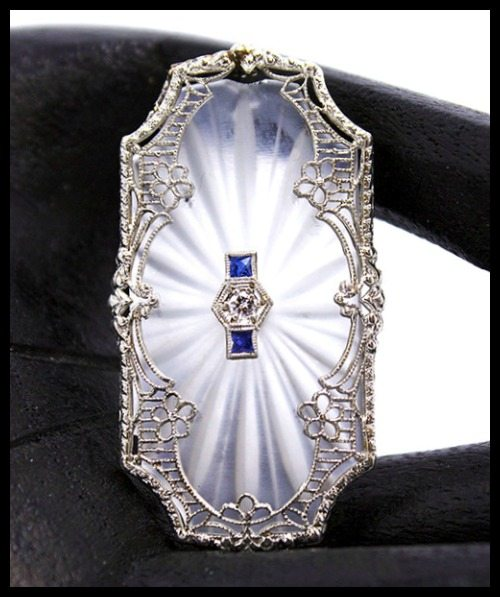 Art Deco camphor glass brooch with sapphires and a diamond.