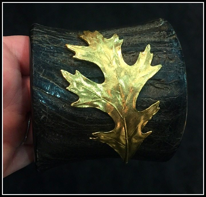 Aaron Henry cuff bracelet made of horn with a gold leaf.