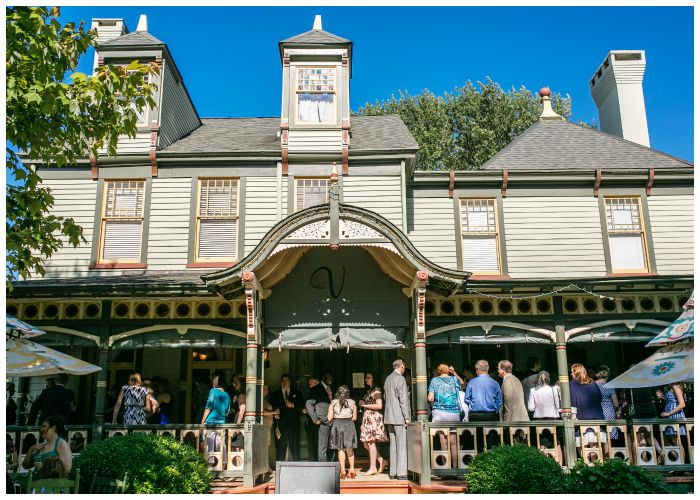 Our guests enjoying cocktail hour on the Vandiver Inn's front porch. Wedding photography by Angel Kidwell.