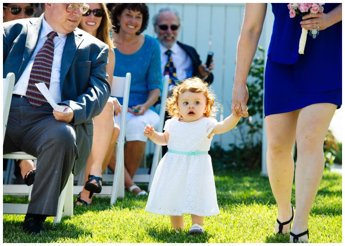 Our tiny niece, comporting her flower girl duties with dignity. Photography by Angel Kidwell.
