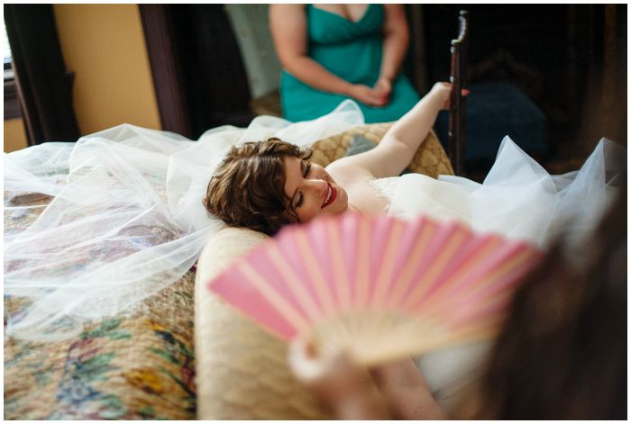 Relaxing in my gown and veil before my wedding ceremony at the Vandiver Inn. Photography by Angel Kidwell.