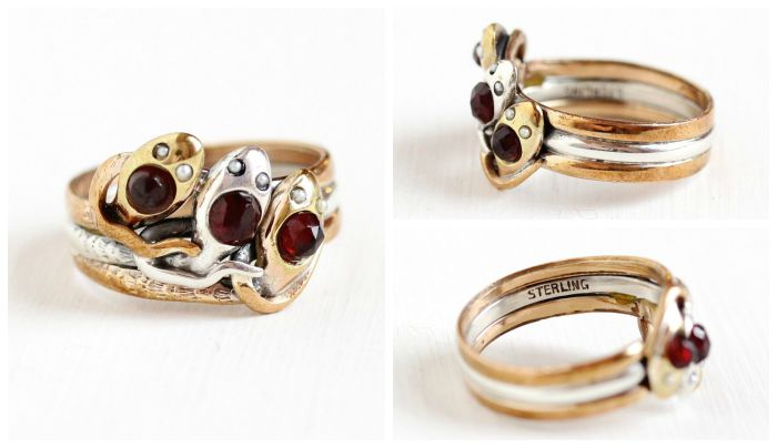 A stunning antique snake ring from the 1930's with rare triple snake design, garnet-set heads, and pearl eyes in gold fill and sterling silver. Circa 1930's; at Maejean Vintage.