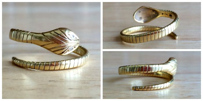 A vintage yellow gold and diamond snake ring from Erie Canal Collectors. Circa 1960's.