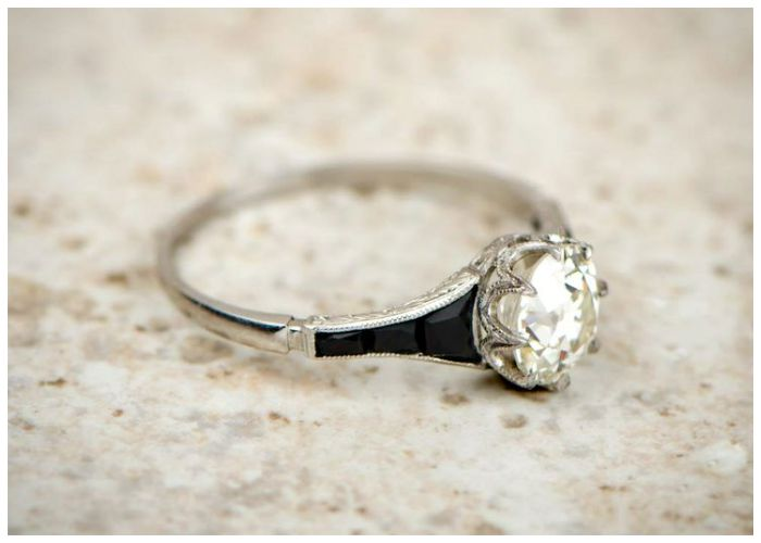 Antique engagement ring with onyx details and a 1.12ct diamond. This beautiful ring is Art Deco, circa 1930.