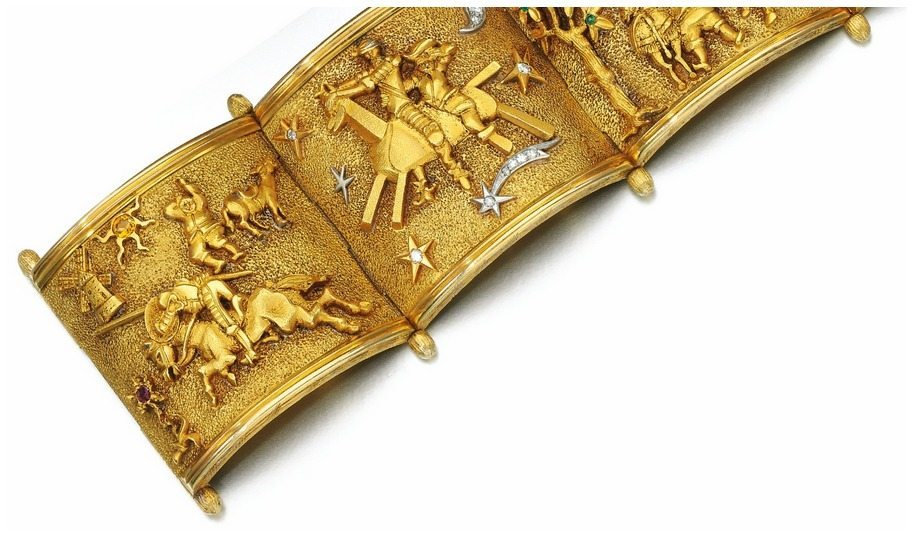 A fabulous bracelet from the 1950's that shows the scenes from the story of Don Quixote. Detail view of front half.