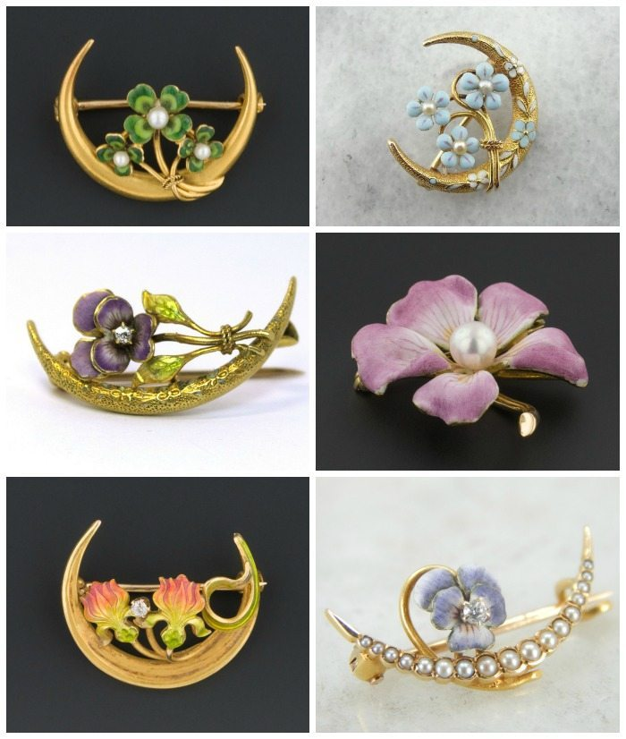 An assortment of antique gold pins featuring enamel flowers. Most feature pearl or diamond accents.