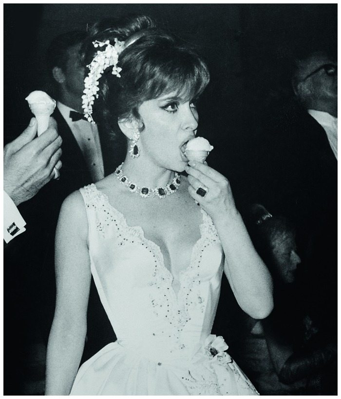 Gina Lollobrigida enjoying an ice cream cone in her Bulgari emeralds and diamonds at the Monaco Centenary Ball in 1966.