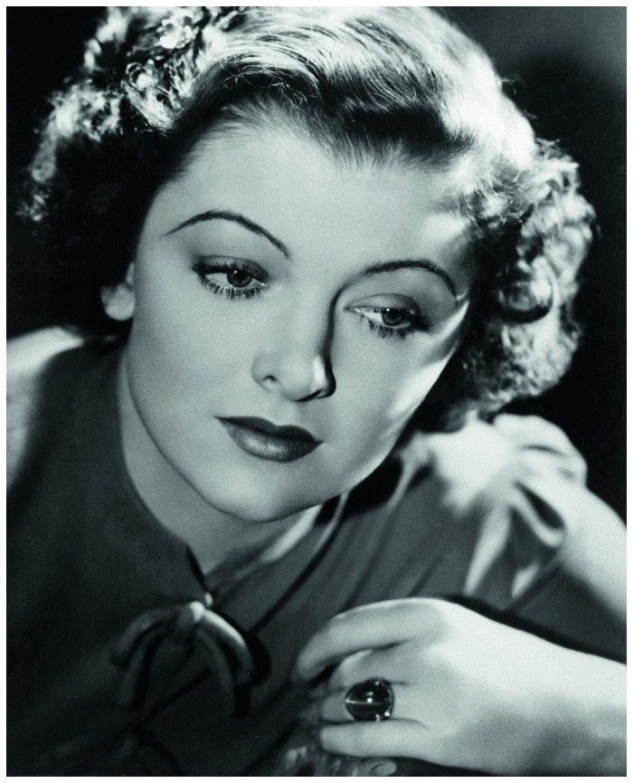 Silver screen siren Myrna Loy wearing her iconic star sapphire and diamond ring.