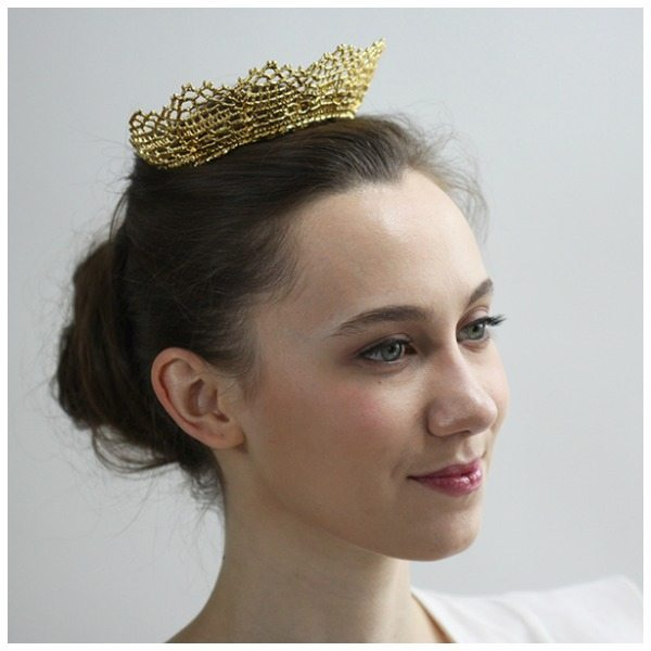 This gold lace tiara by Monika Knutsson is made from actual antique lace dipped in 24k gold.