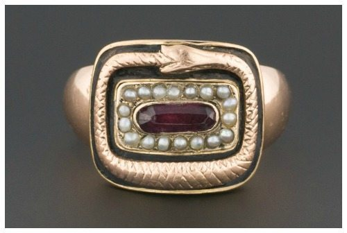 An antique Georgian snake mourning ring with garnet, black enamel, and pearls.