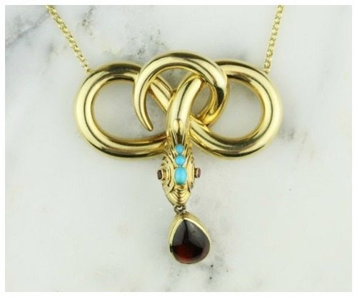 An antique Regency 15k yellow gold turquoise, ruby and garnet snake mourning necklace with hair memento.