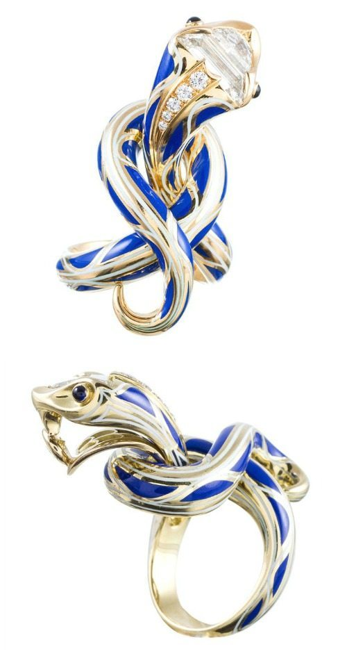 An enamel serpent ring by Juan daSilva in yellow gold with blue enamel and fancy-cut diamonds.
