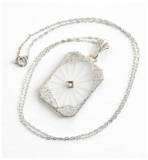 Antique Art Deco white gold and rock crystal necklace with filigree details. Circa 1920's.