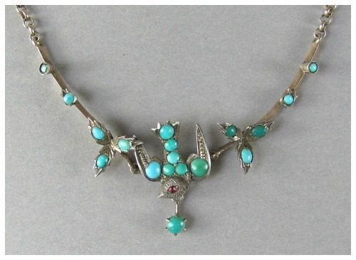Antique Victorian silver bird necklace with turquoise and and ruby eye.