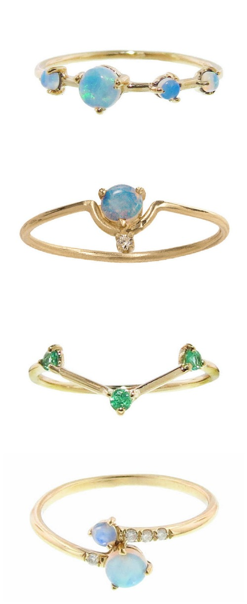 Four tiny gemstone rings by Wwake with opals, diamonds, andor emeralds in gold.