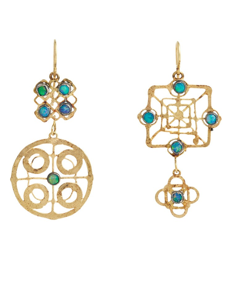 Judy Geib mismatched earrings in gold with opals.