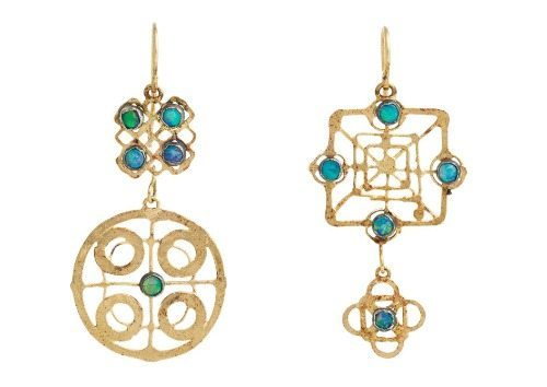 Judy Geib's mismatched earrings in gold with opals.