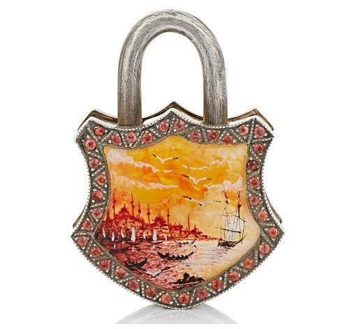 Sevan Biçakçi's painted seascape padlock with orange sapphires.