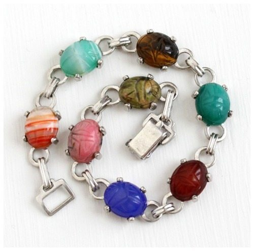 Vintage 1950's scarab bracelet in sterling silver with carved tigers eye, carnelian, banded agate, unakite, chalcedony, and rhodonite.