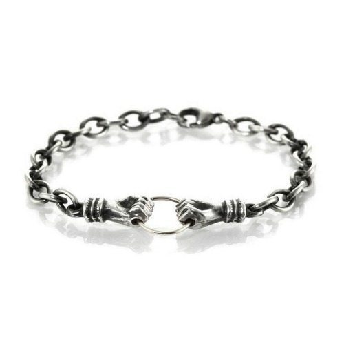 Workhorse's Una bracelet in sterling silver with hands clasping a ring.