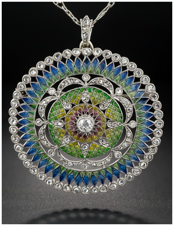 A colorful antique Belle Epoque plique-a-jour enamel pendant brooch with diamonds.