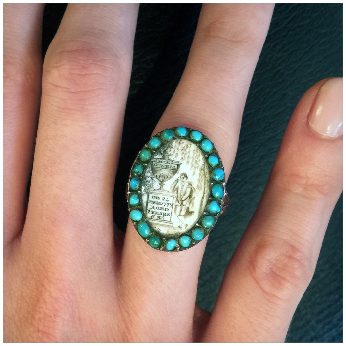 An exceptionally rare antique Georgian sepia mourning ring with a turquoise halo. Circa 1700s.