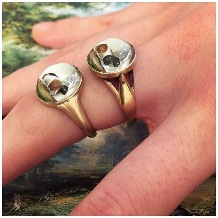 These two rings feature rare reverse painted crystal guinea pig elements, converted from antique stickpins. By Antique Animal Jewelry.