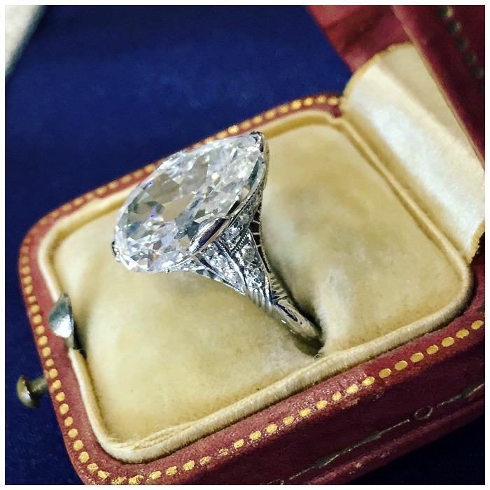 A glorious antique 5 carat pear cut diamond ring from Jogani in a filigree-adorned setting.