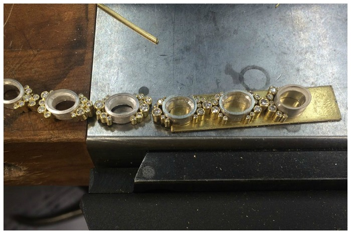 Gold and diamond bezels for a tourmaline and diamond necklace in the making at Todd Reed