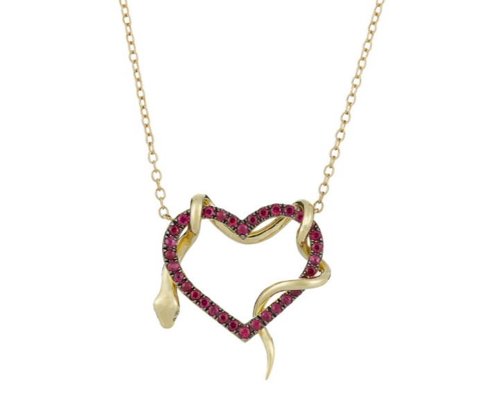 A ruby heart and snake pendant necklace by Finn. In gold, with diamond eyes on the snake.