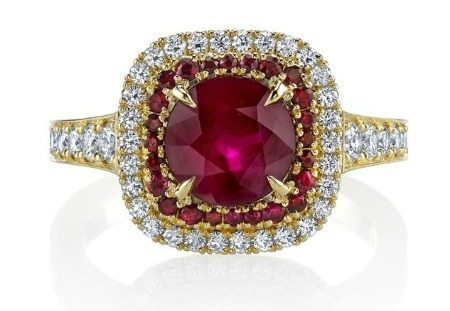 A ruby ring by Omi Prive with rubies and diamonds in platinum and rose gold.