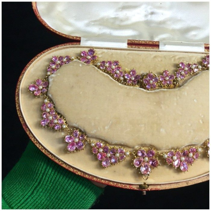 An exceptional antique pink topaz and pearl necklace in gold. With foiled-back gemstones, dating to the Georgian era. From Spicer Warin.