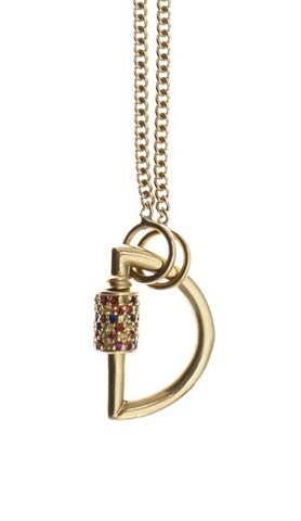 A Marla Aaron baby lock with set with colorful gemstones and attached to a gold chain.