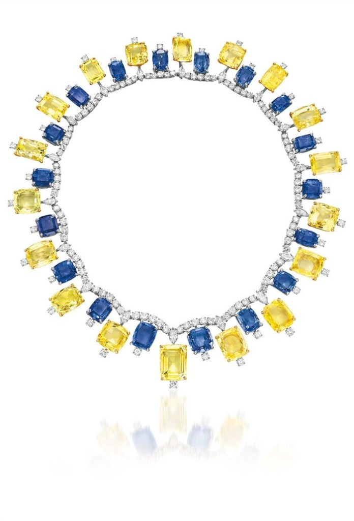 A vibrant blue and yellow sapphire necklace by Cartier, with diamonds. Retro, circa 1957.