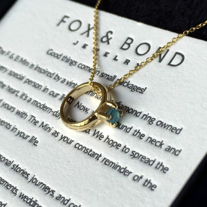 My Fox and Bond mini in 14k gold with an aquamarine. It's engraved on the inside with a 'B' for my first name.