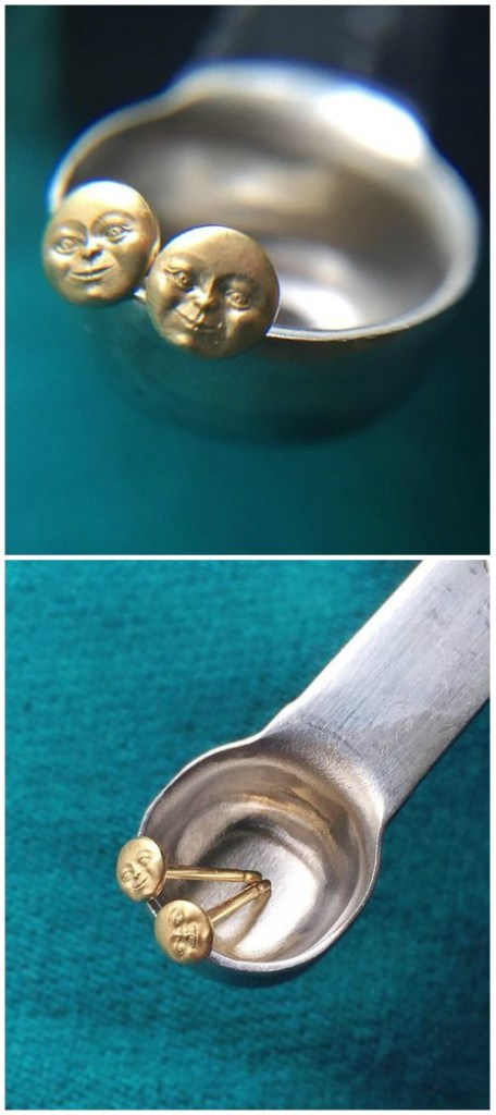 The Anthony Lent micro moonface stud earrings in gold. So tiny, they're shown here in a one eighth tsp measuring spoon.