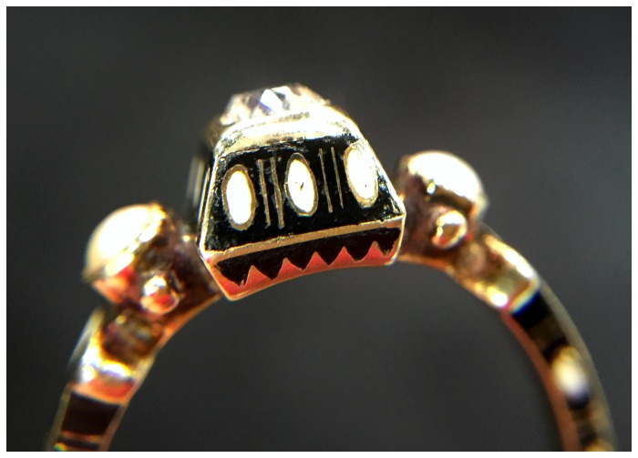 Zoom detail of a beautiful Renaissance revival diamond ring in gold with black and white enamel details. At Roy Rover.