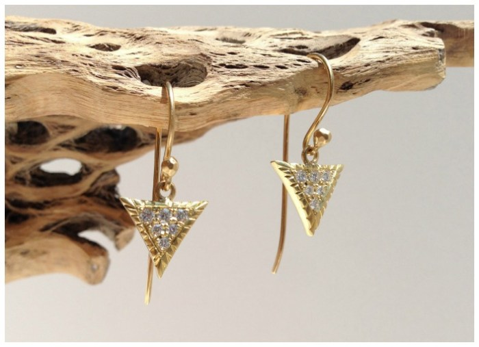 The large pave Scale earrings in gold with diamonds. From Lisa Kim's newest jewelry collection, The Seabeast.
